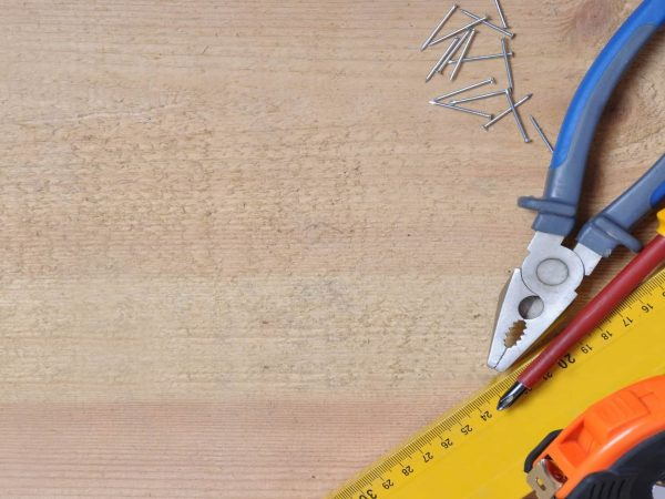 10692066 – complete of tools on a wooden background