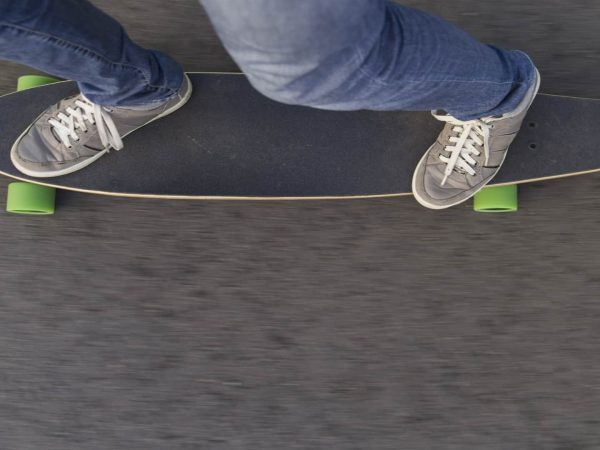 Fast longboard riding, top view. Concept Extreme Hipster