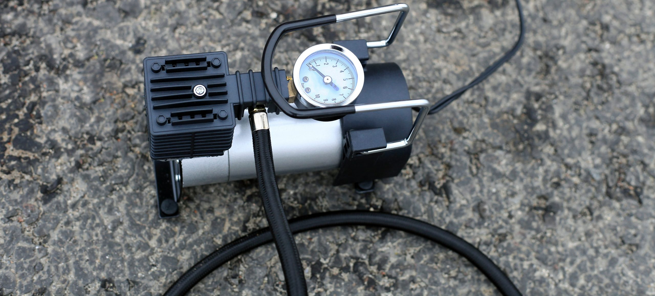 Portable metal air compressor pump for car wheels, driver equipment