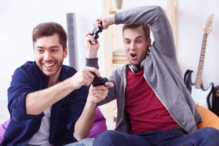Guys playing videogames