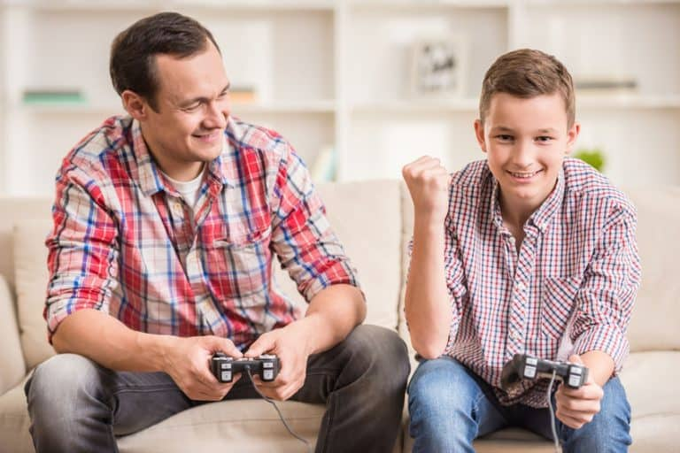father and son playing videogames
