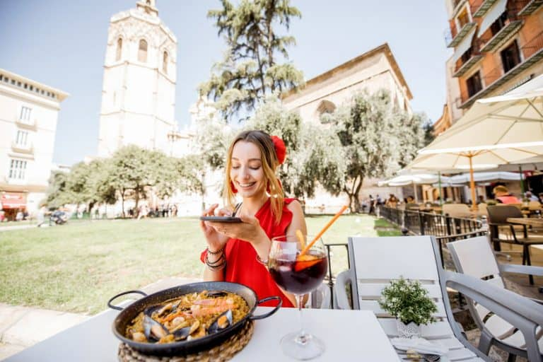 Girl eating a paella