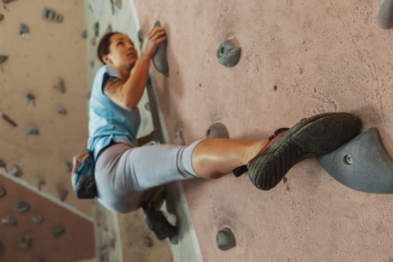 girl climbing a wall
