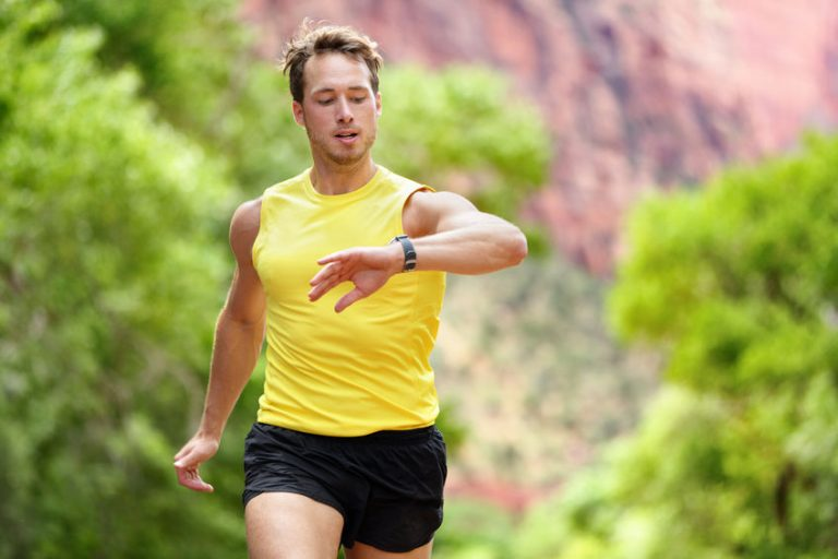 Runner looking at heart rate monitor smartwatch