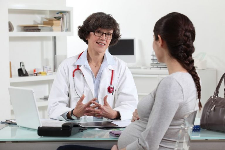 doctor speaking with a pregnant girl