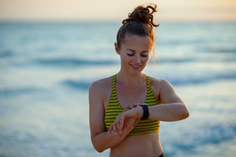 girl doing exercise on the beach