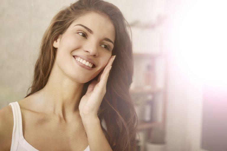girl applying facial cleaner