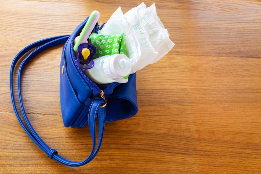 women handbag with items to care for the child
