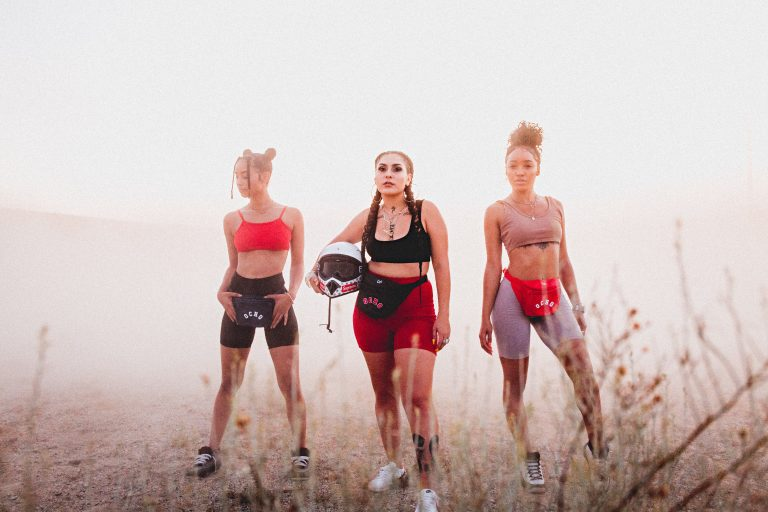 three girls with waist bags