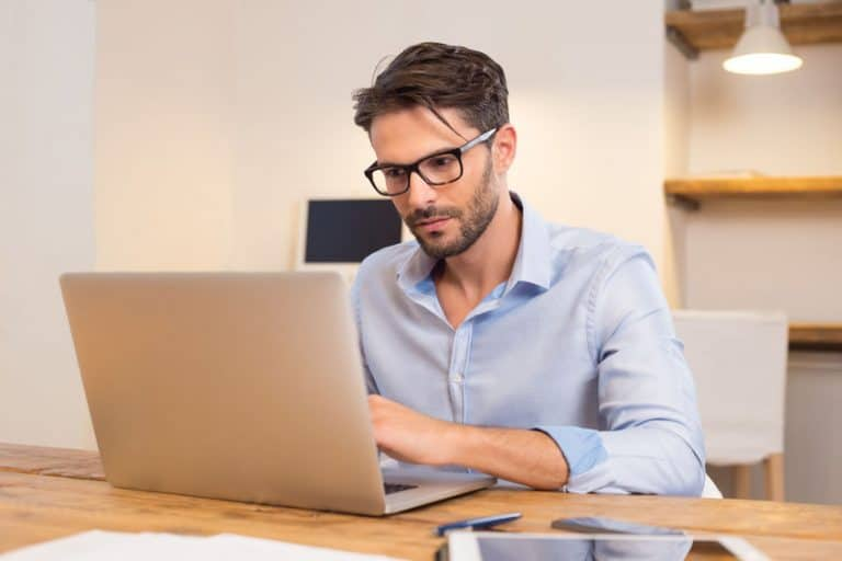 guy wearing glasses using a computer