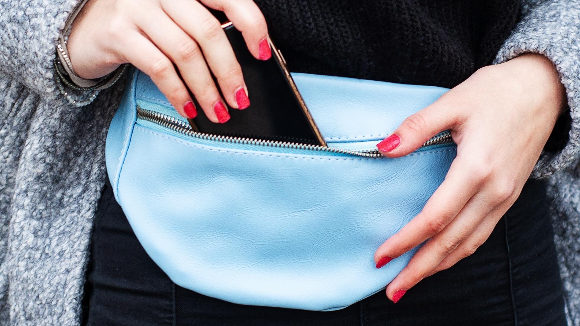 putting a phone in a waist bag