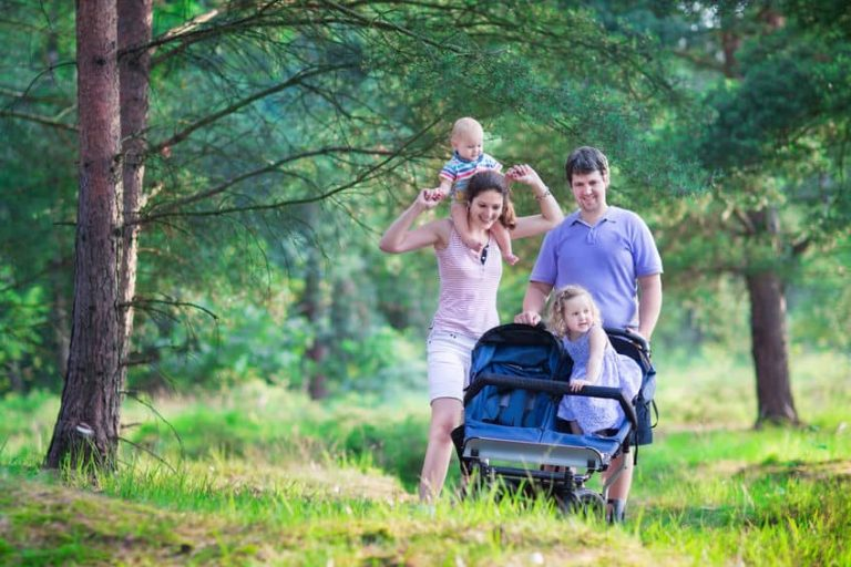 family traveling in the forest