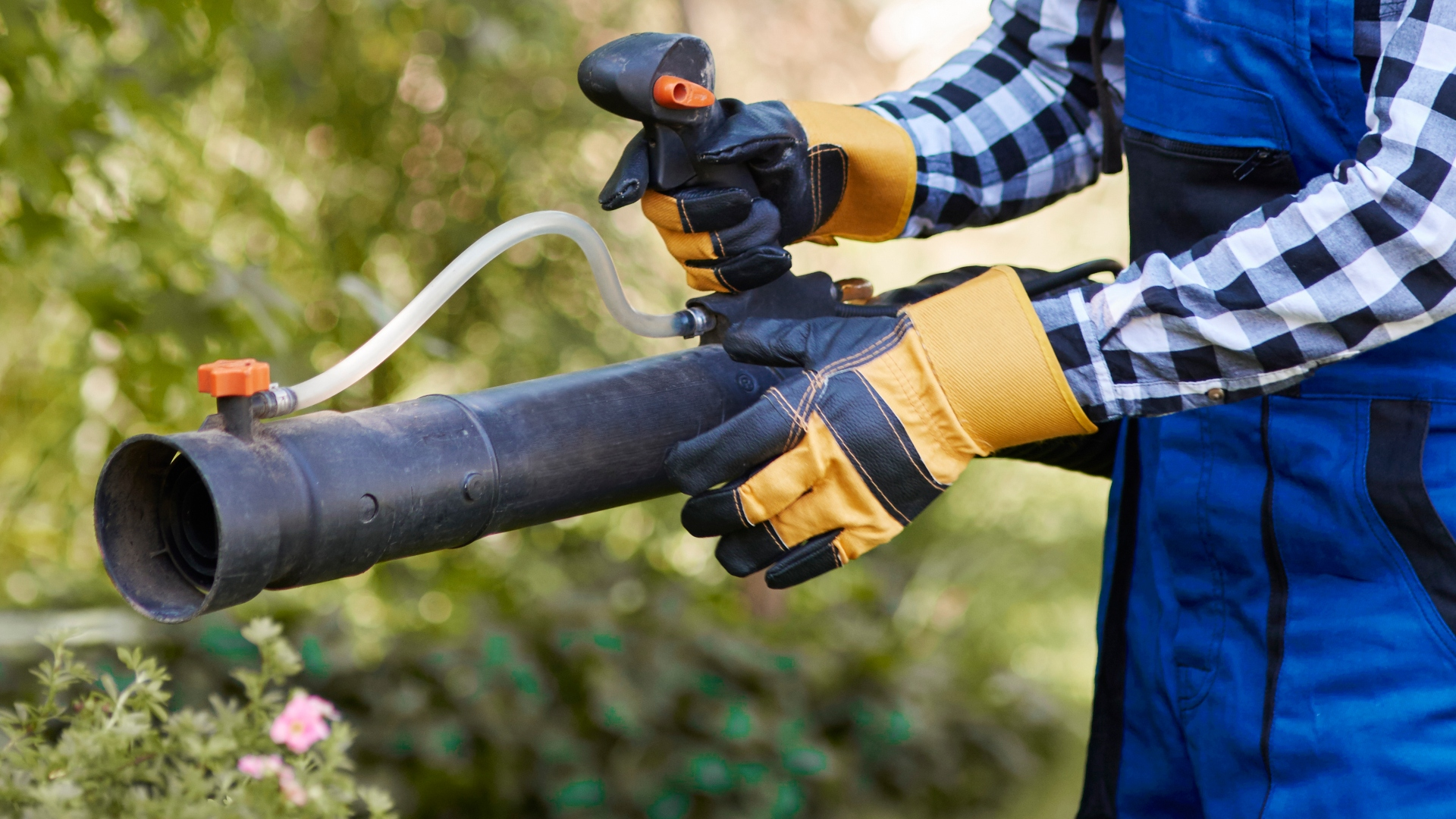 Gardener using modern gardening equipment