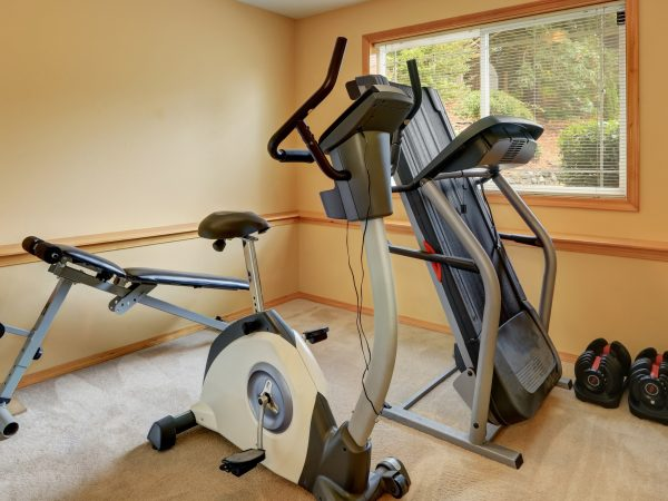 elliptical machine and dumbells