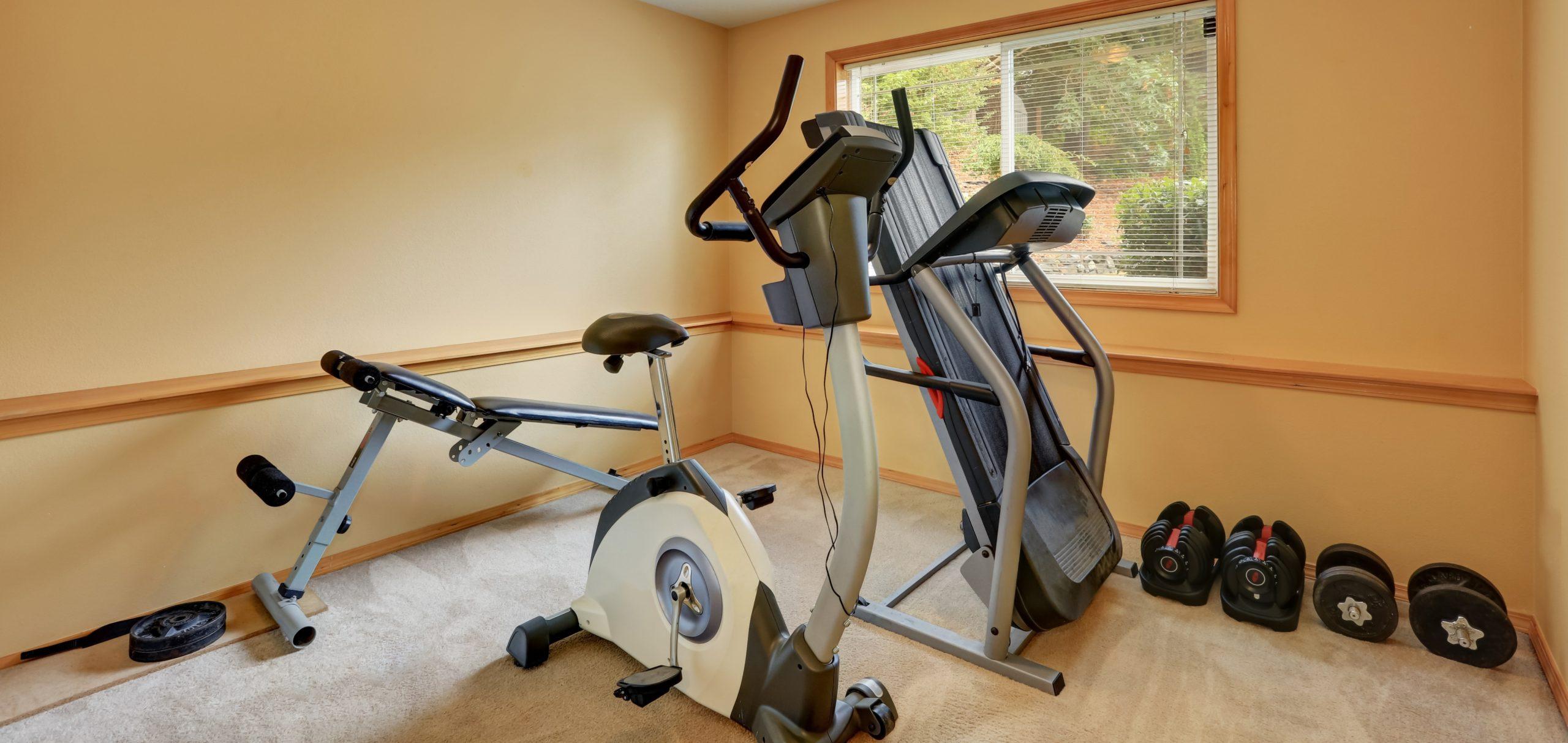 elliptical machine and dumbells