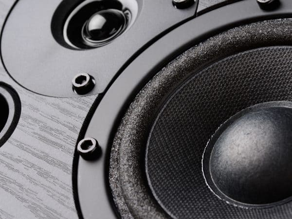 Multimedia speaker system with different speakers closeup over black background