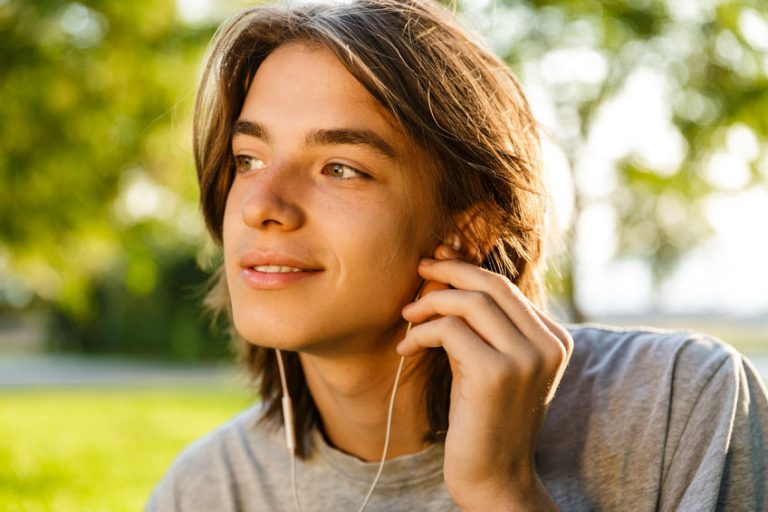 young guy listen music