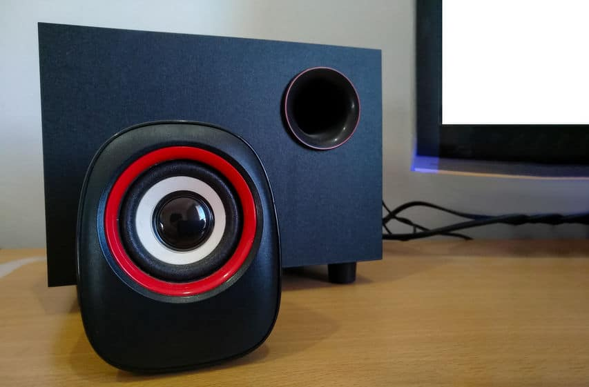 PC speaker and amplifier on table with  display monitor