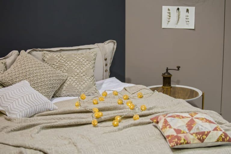 Knitted bed linens, knitted pillow cases, pillows, bedspreads, gray beige colors, Scandinavian style.