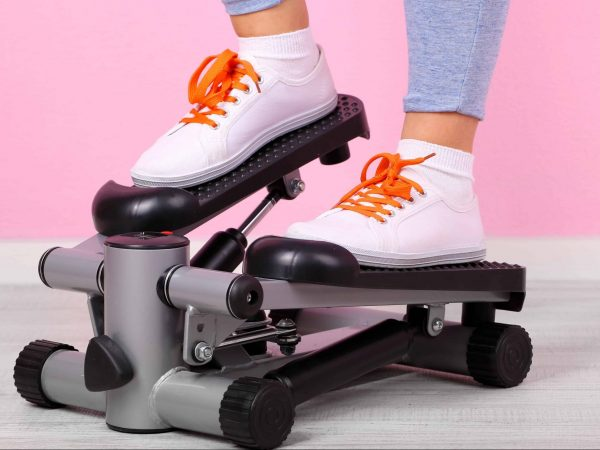 girl on step machine