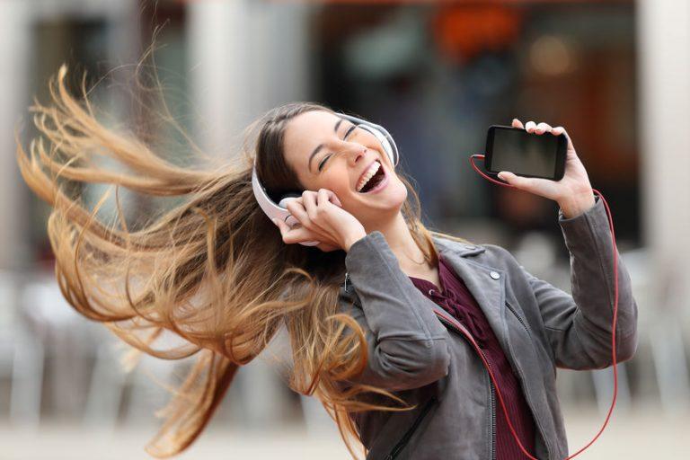 excited girl listen music