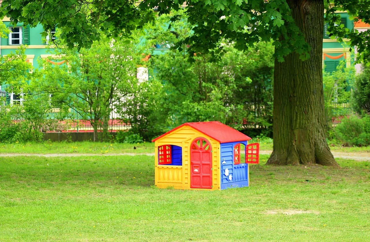 little toy house in front a tree