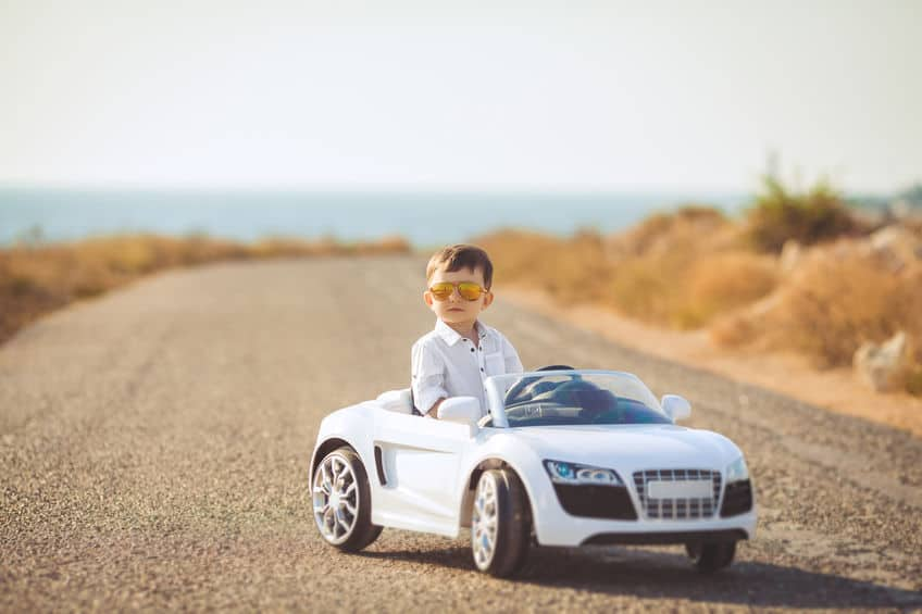little kid on a audi car toy