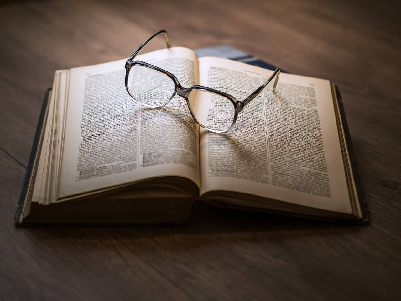 open book with glasses on