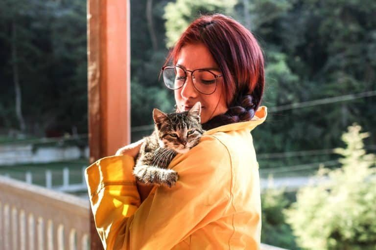 redhead girl with a cat