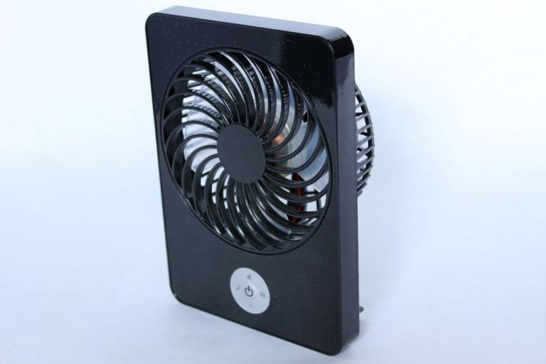 a refreshing black portable and rechargeable fan
