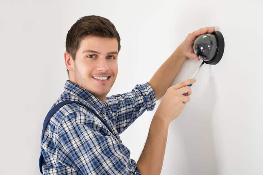 Technician Installing Surveillance Camera