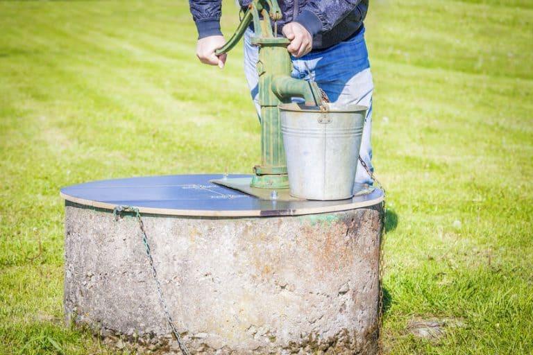 man pumping water
