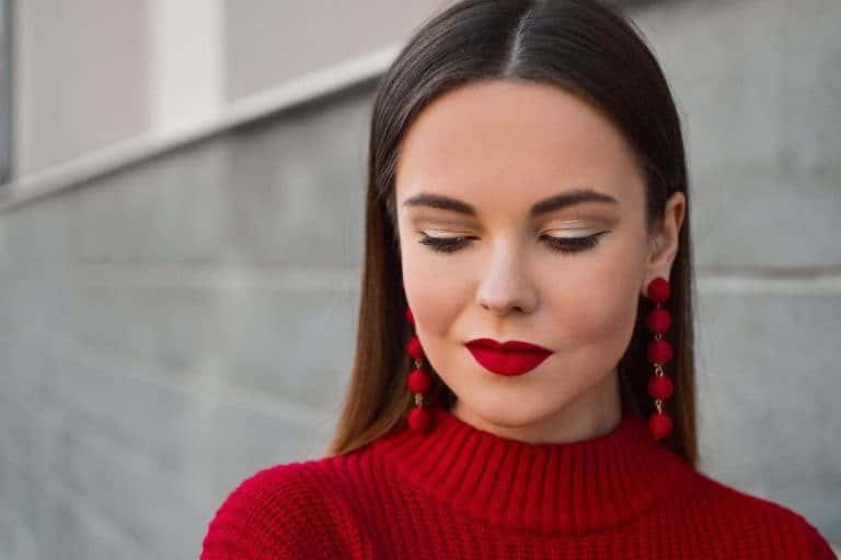 Model with red clothes and lipstick