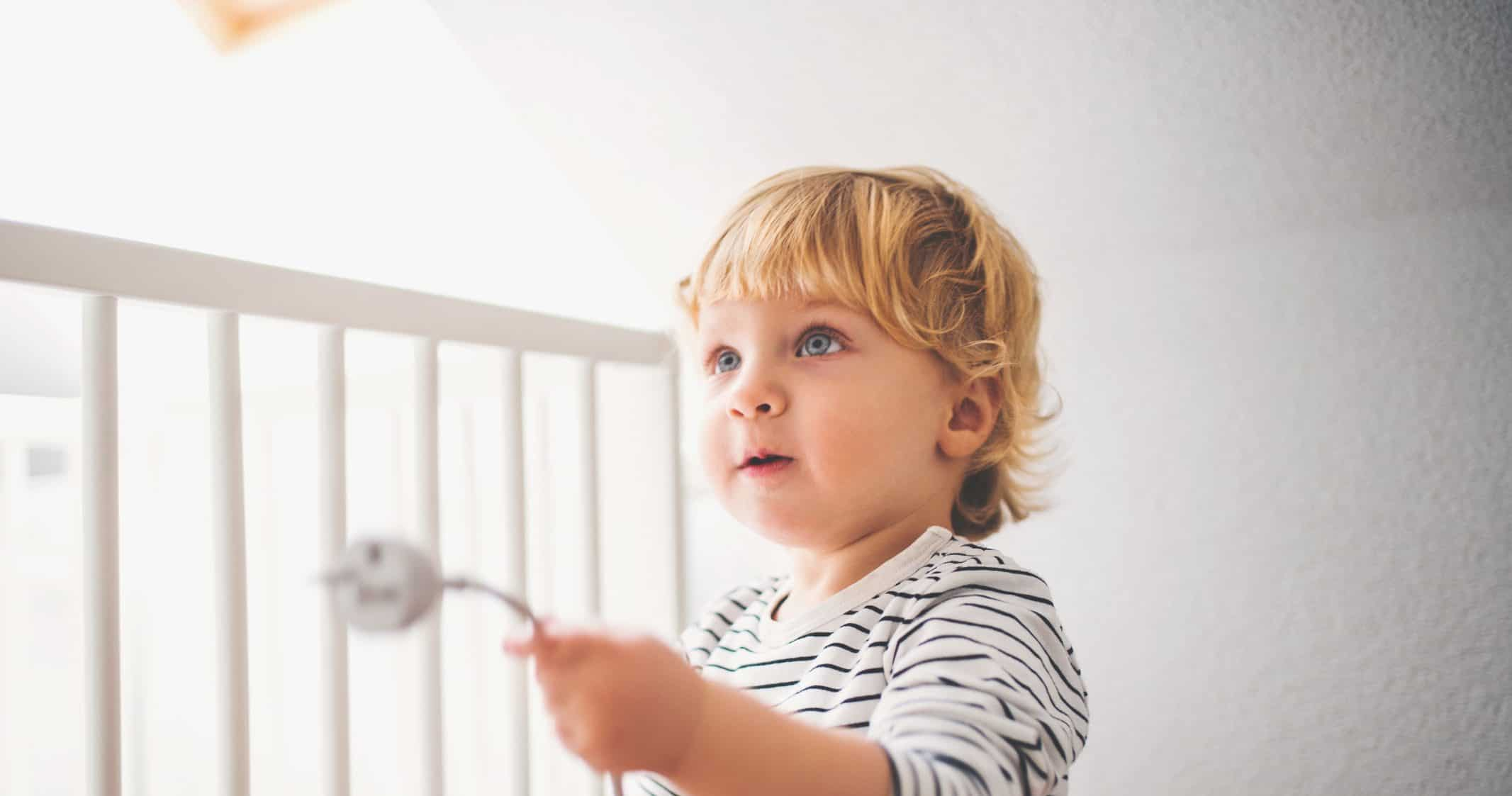 Toddler boy in a dangerous situation at home.
