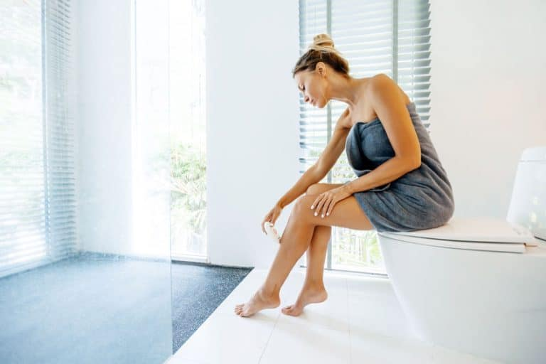 Woman making hair removal at home