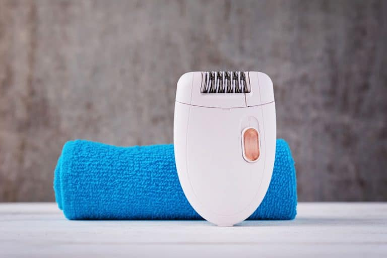 Close up of epilator on background with towel