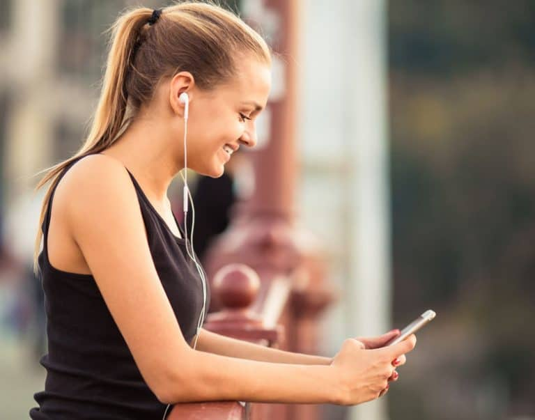 Girl Running town with ear phones